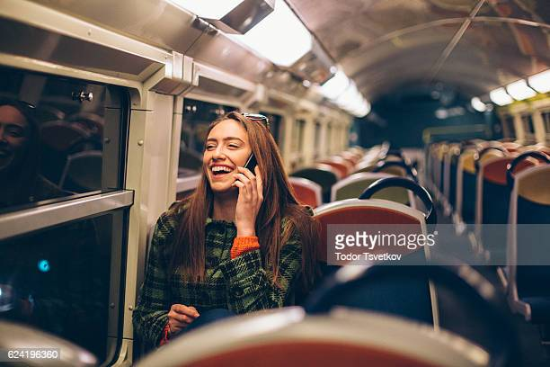 Woman talking on the phone in the train