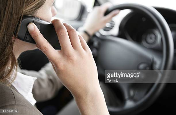 Woman talking on the phone while driving a car