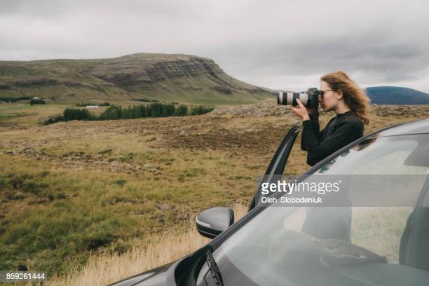 Woman talking photo of scenic landscape of mountains in Iceland