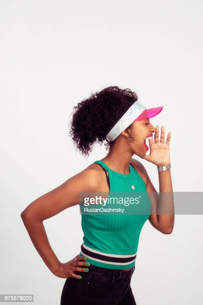 Woman talking, speaking out loud with palm hand on cheek.