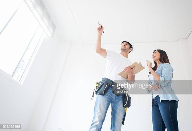 Woman talking to a construction worker