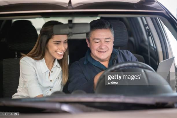 Woman talking to a mechanic at an auto repair shop