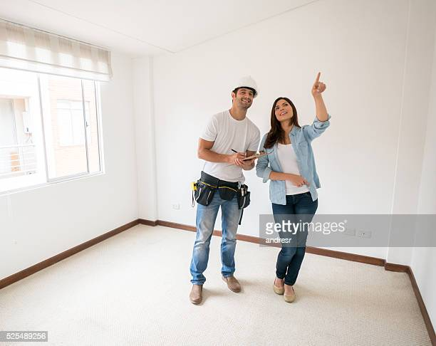 Woman talking to construction worker about a housing project