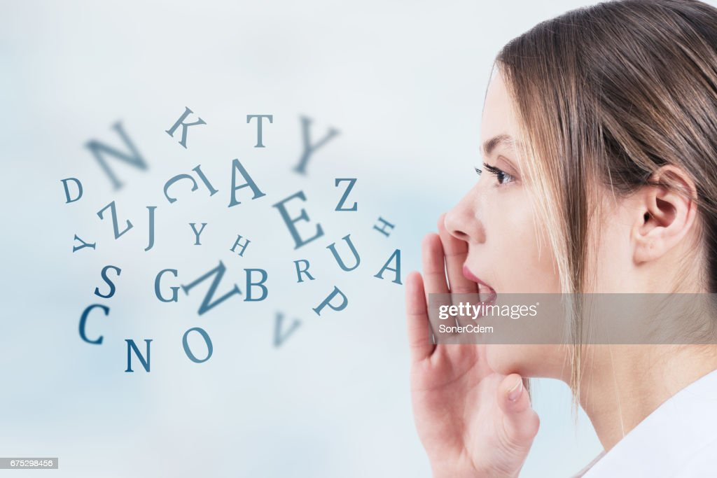 Woman talking with alphabet letters coming out of her mouth. Communication concept : Stock Photo