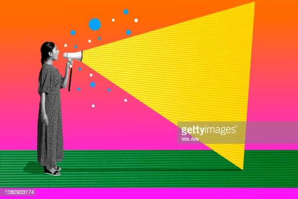 woman talking with megaphone - positive emotion stock pictures, royalty-free photos & images