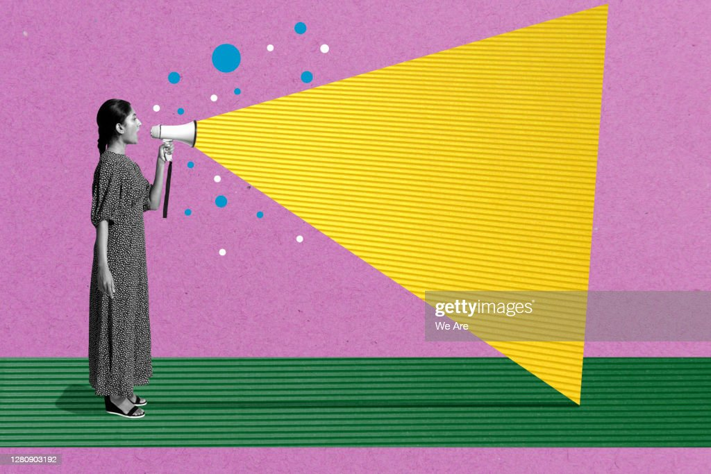 woman talking with megaphone : Stock Photo