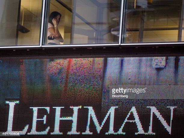 A woman talks on a cell phone inside the headquarters of Lehman Brothers Holdings Inc in New York US on Sept 15 2008 Two weeks after Lehman Brothers'...