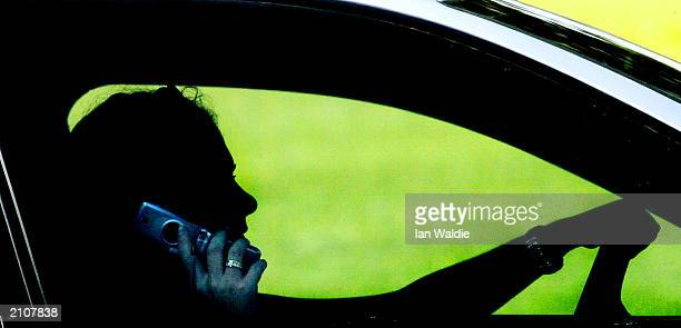 A woman talks on a mobile phone while driving in traffic June 24 2003 in London England The government has announced plans for a ban on talking on...