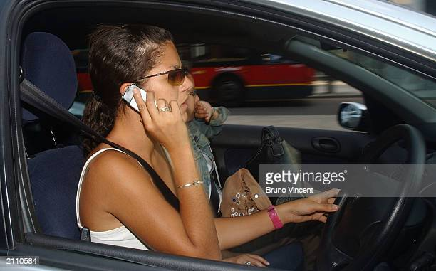 A woman talks on a mobile phone whilst driving in traffic on June 24 2003 in London England The government has announced plans for a ban on talking...