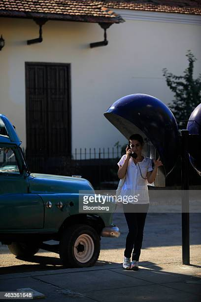 A woman talks on a public phone in Santiago de Cuba Cuba on Sunday Jan 18 2015 US companies will be permitted to export to Cuba telecommunications...