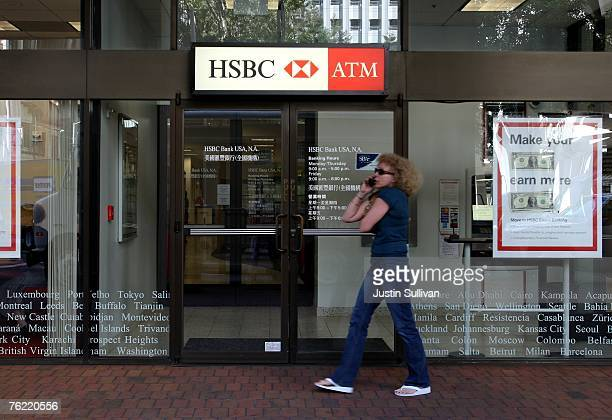 A woman talks on her phone as she walks by an HSBC bank branch August 22 2007 in San Francisco California London based HSBC Europe's largest bank...