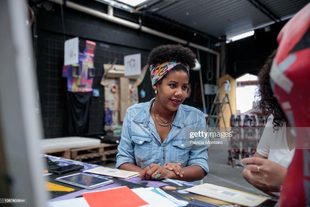 Woman talks to a colleague at an art center in Rio de Janeiro : ストックフォト
