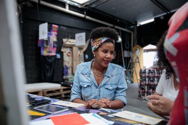 Woman talks to a colleague at an art center in Rio de Janeiro