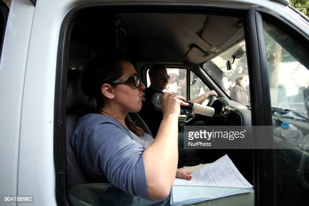 A woman talks to a microphone during a 24hours strike in Athens Greece on January 12 2018 by Greek Unions against changes to labour law and new...