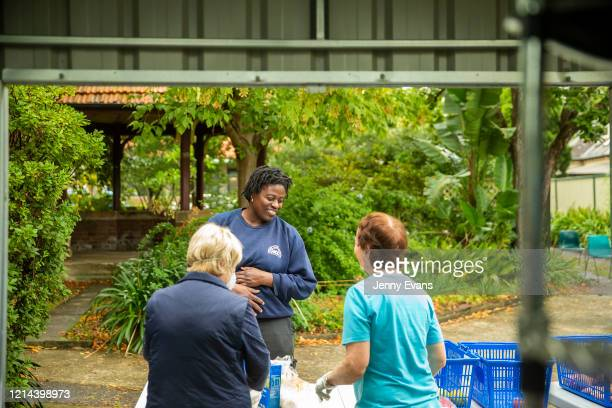 A woman talks to volunteers Margaret Baseley and Kerin Brown at St Paul's Anglican Church in Burwood on March 24 2020 in Sydney Australia The Parish...