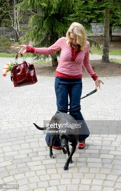 woman tangled up in her dog's leash - dog knotted in woman stock pictures, royalty-free photos & images