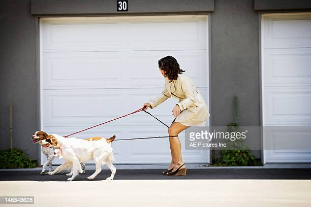 woman tangled up in her dog's leashes - dog knotted in woman stock pictures, royalty-free photos & images