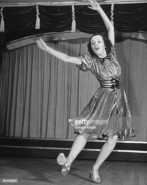 A woman tapdancing onstage at the Paradise Club