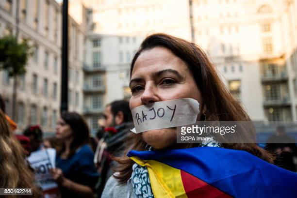 A woman taped her mouth with the Spanish Prime Minister name Mariano Rajoy Spanish Civil Guard police have arrested several Catalan government...