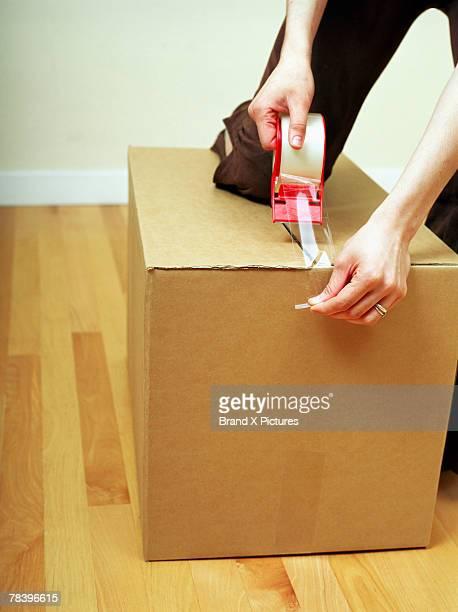 Woman taping box