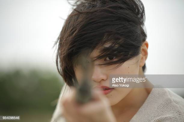 A woman targeting something on the beach