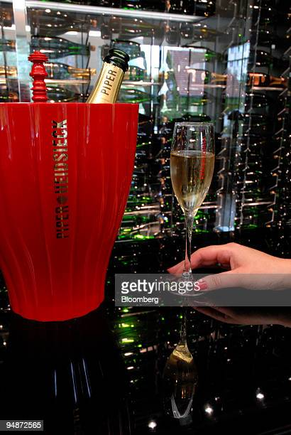 Woman tastes champagne at the Piper-Heidsieck champagne factory, owned by Remy-Cointreau, in Reims, France, on Monday, July 21, 2008. Remy Cointreau...