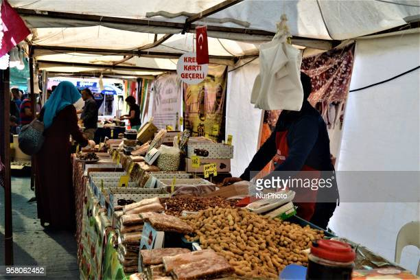 A woman tastes local goods in a bazaar ahead of the start of the Muslim holy fasting month of Ramadan in Ankara Turkey on Sunday May 13 2018 Turkish...