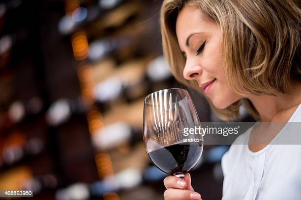Woman tasting wine at a cellar