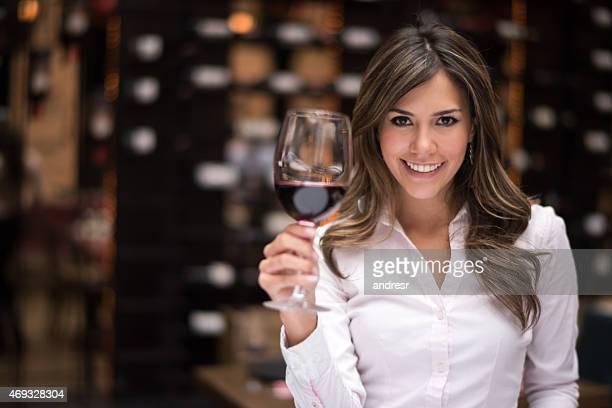 Woman tasting wine at a cellar
