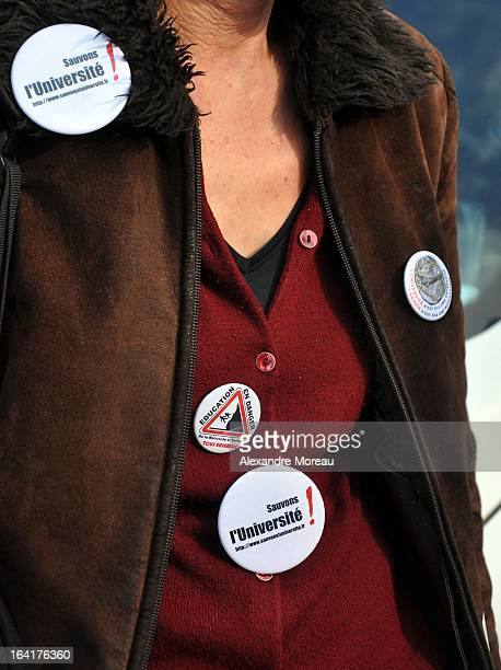 CONTENT] Woman teacher with badges during french demonstration against education and university reforms Striking action by French researchers...