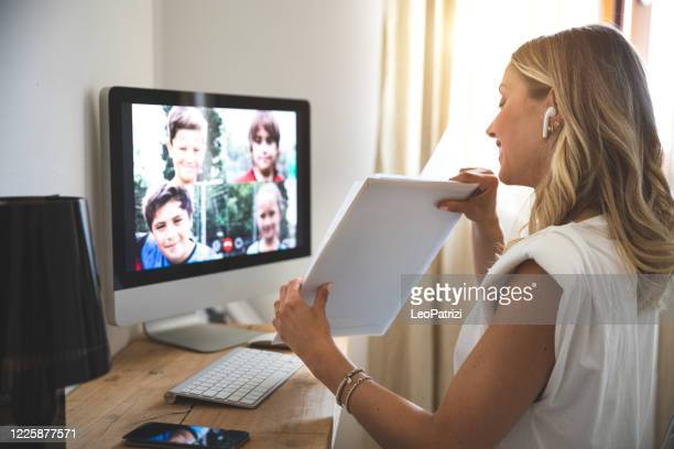 woman teaching from home to young students - demonstration stock pictures, royalty-free photos & images