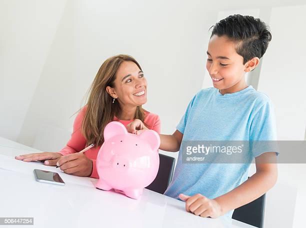 Woman teaching son to save money