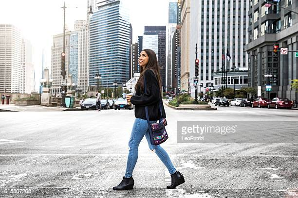 Woman teen in Chicago downtown having fun waiting for friends