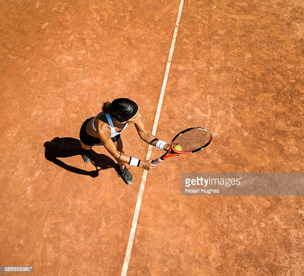 Woman tennis player about to hit a serve