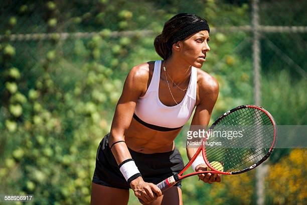 Woman tennis player about to serve