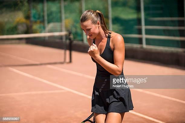 Woman tennis player celebrating after winning