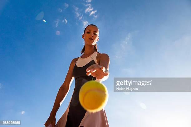 Woman tennis player preparing to serve