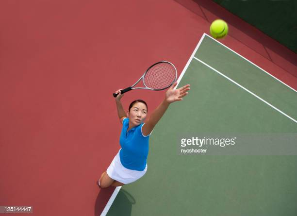 woman tennis player serving - tennis player stock pictures, royalty-free photos & images