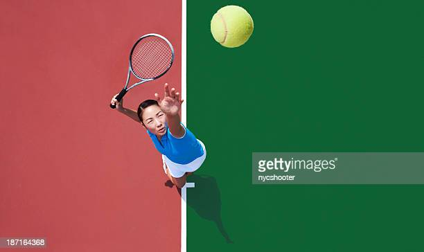 woman tennis player serving - tennis stock pictures, royalty-free photos & images
