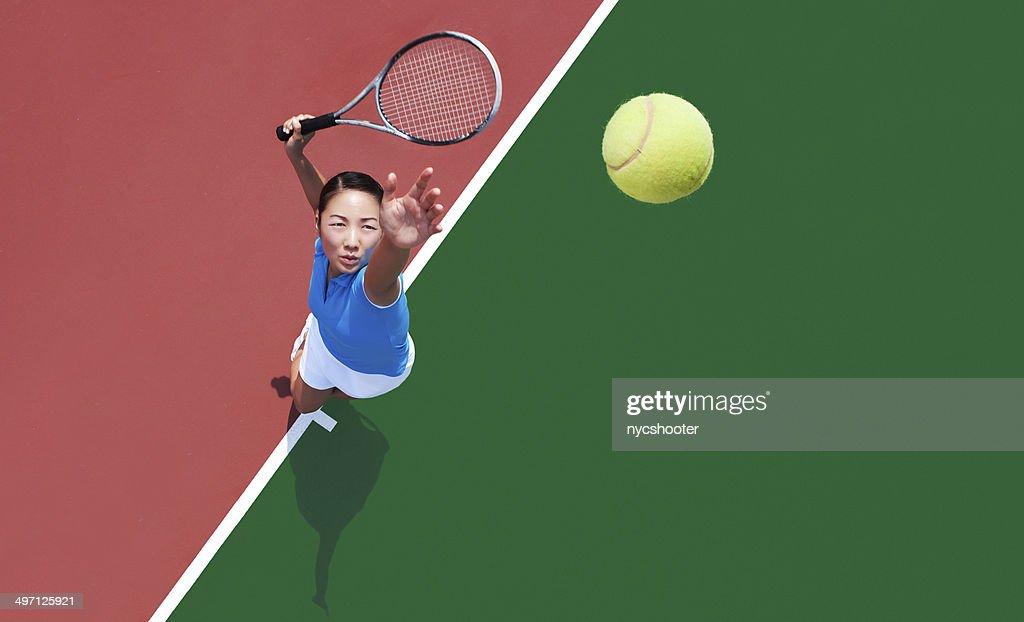 woman tennis player serving : Stock Photo