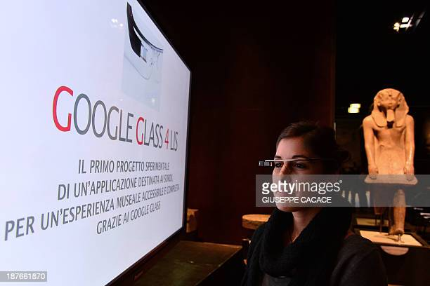 A woman tests a pair of Google glasses equiped with LIS capabilities and created to help deaf people during their visit of the Egyptian Museum in...
