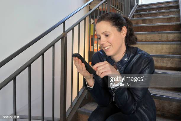 Woman text messaging on a mobile phone