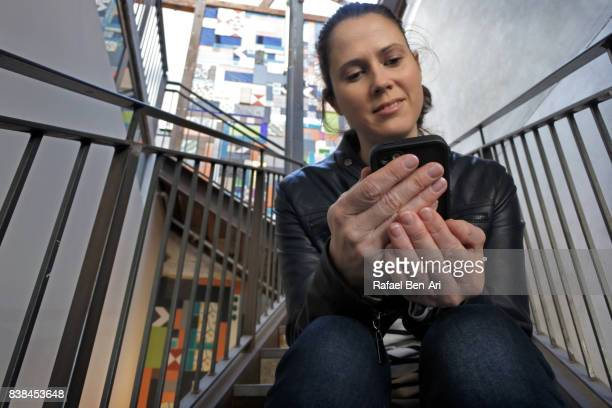 Woman text messaging on a mobile
