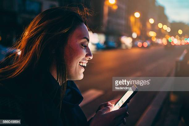 Woman texting at night