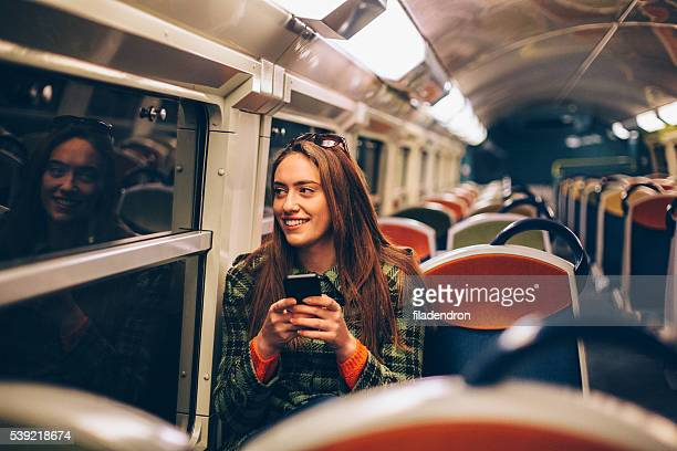 Woman texting in the metro
