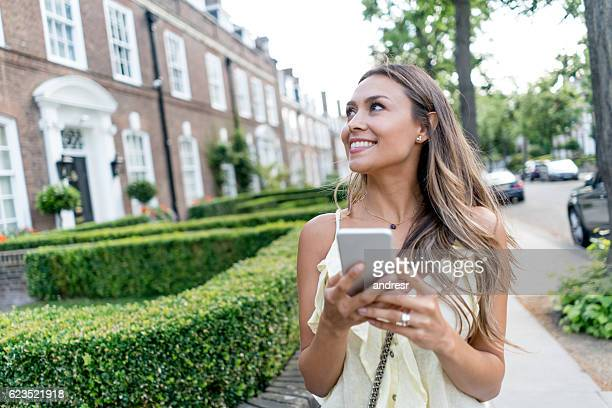 Woman texting on her phone outdoors