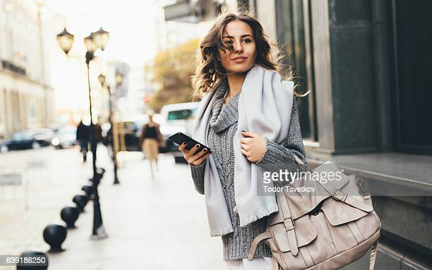 woman texting outdoors - a fall from grace stock pictures, royalty-free photos & images