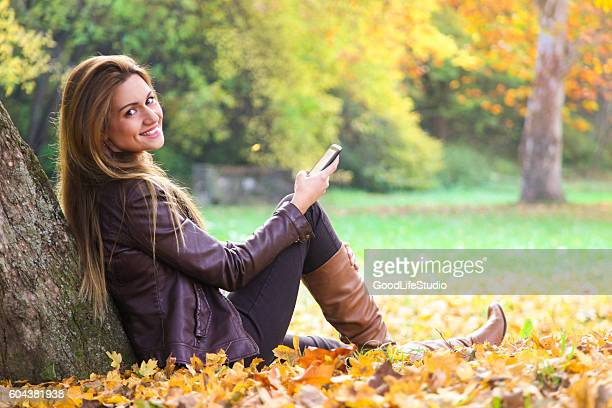 woman texting - leather boot stock pictures, royalty-free photos & images