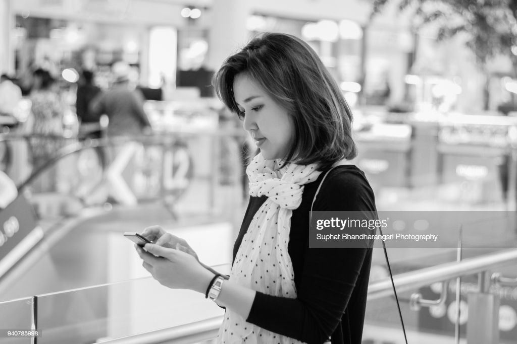 Woman texting someone on mobile phone : Stock Photo