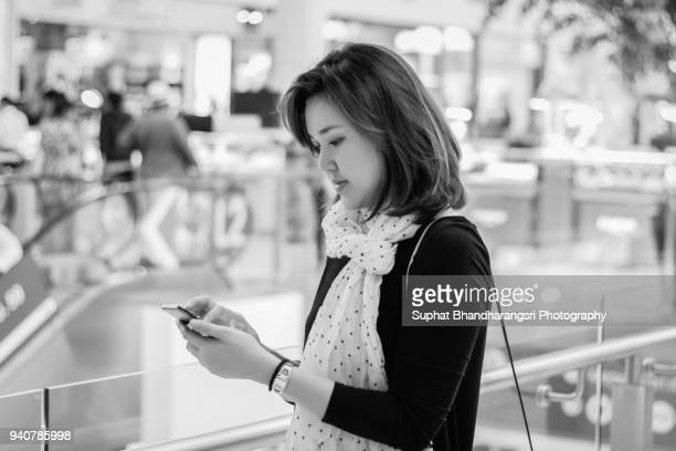 Woman texting someone on mobile phone
